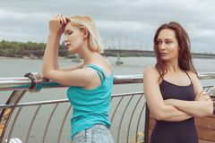 Women are offended at her friend. The women are standing on the bridge, they quarreled Royalty Free Stock Photo