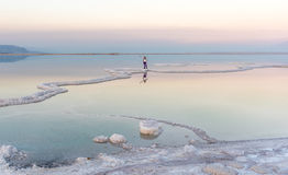 Women standing in the Dead Sea at Sunset Royalty Free Stock Image