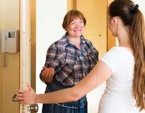 Women standing by the doorway Stock Photo