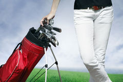 Women standing by golf bag Royalty Free Stock Photos