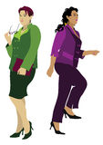 Women standing and moving upstairs. Business women in costumes, standing and moving upstairs Royalty Free Stock Image