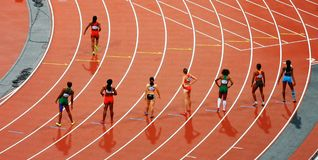 Women Standing on Race Track While Preparing for a Run Race during Daytime Royalty Free Stock Photos