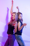 Women standing in a row toasting Stock Photos