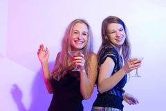 Women standing in a row toasting Royalty Free Stock Photography