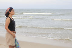 Women standing beside sea beach Royalty Free Stock Images