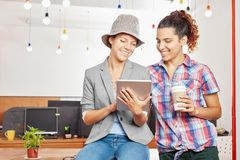 Women in start up as students. Using tablet for internet social media Stock Photography