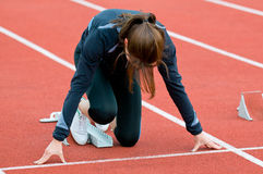 Women in the starting block. A women at training in the starting block Royalty Free Stock Photography