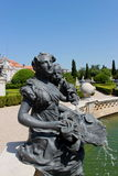 Women Statue. Statue from a women and a child in Queluz Palace Stock Photo