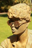 Women Statue. Statue from a Women with glasses in a garden Stock Photo