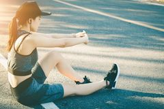 Women stops resting after running. Young woman stops resting after running Royalty Free Stock Photography