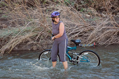 Women in stream with bike Stock Photos