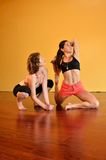 Women in Strenuous Yoga Royalty Free Stock Image