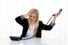 Women with stress in the office Royalty Free Stock Image