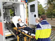 Women on stretcher with stifneck and Ambulance after accident Royalty Free Stock Image