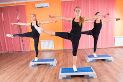 Women Stretching Arms and Legs on Top of Platforms Stock Images