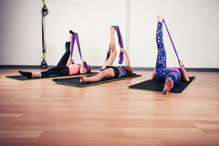 Women stretching with bands Royalty Free Stock Image