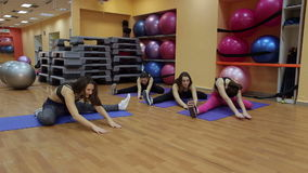 Women stretching in fitness club. stock video footage