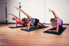 Women stretching in the gym Royalty Free Stock Images