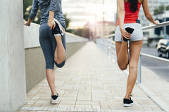 Women stretching outdoor Royalty Free Stock Image