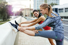 Women stretching outdoor Royalty Free Stock Photos