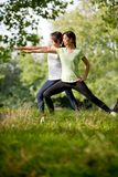 Women stretching outdoors Royalty Free Stock Photo
