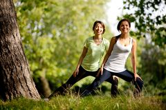 Women stretching outdoors Stock Image