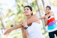 Women stretching at the park Royalty Free Stock Image
