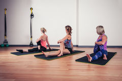 Women stretching their backs in gym Royalty Free Stock Photos
