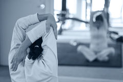 Women stretching up. Health club: women doing stretching. Nice atmosphere and shallow focus on her face stock photos