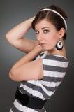 Women in striped dress Stock Image
