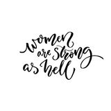 Women are strong as hell. Feminism quote for t-shirt and cards. Black calligraphy isolated on white background Stock Image