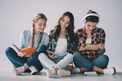 Women students with textbooks studying together Royalty Free Stock Image