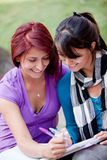 Women studying outdoors Royalty Free Stock Images