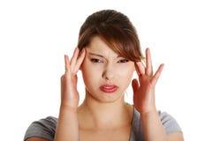 Women suffering from headache Royalty Free Stock Image