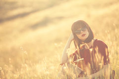 Women with suitcase on autumn meadow Royalty Free Stock Image