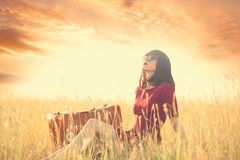 Women with suitcase on autumn meadow Stock Photography