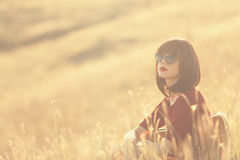 Women with suitcase on autumn meadow Stock Image