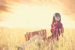 Women with suitcase on autumn meadow Royalty Free Stock Images