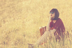 Women with suitcase on autumn meadow Royalty Free Stock Photo