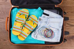Women summer beach clothes in suitcase. Top view, flat lay stock photos