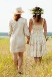 Women on summer field. Rear view of two women on summer field royalty free stock photo