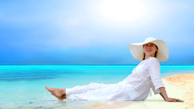 Women on the sunny tropical beach Stock Images