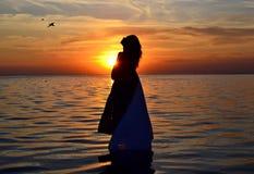 Women at sunset. Royalty Free Stock Image