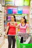 Women in supermarket royalty free stock photos