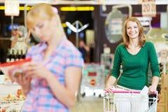 Women at supermarket shopping Royalty Free Stock Photos