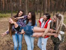 Women support  team tourism concept. Active leisure in the forest Stock Photos