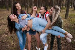 Women support  team tourism concept. Active leisure in the forest Royalty Free Stock Image