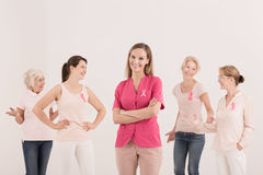 Women supporting fight with cancer. Confident women supporting fight with breast cancer royalty free stock images