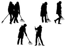 Women, sweeping leaves Stock Photos