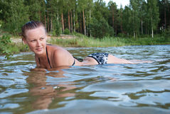 Women swimming lake summer Stock Images